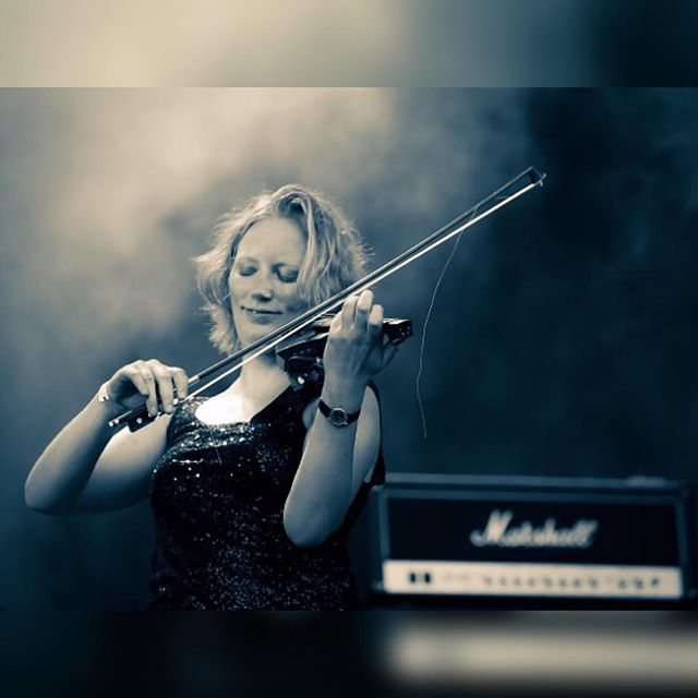 Our fiery redhead showing off her fiddle skills at Sweden Rock Festival last year! #sirregband #swedenrock #swedenrockfestival #celticpunk #tbt #throwback